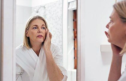 woman-examining-skin-during-menopause.jpg